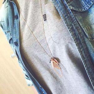 Henri Bendel long necklace with multiple pendants